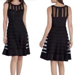 SLEEVELESS ICONIC COQUETTE BANDED FIT&FLARE DRESS